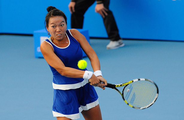 The USA's Vania King stuns Hungary's Timea Babos to reach the Rogers Cup second round.