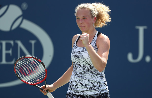 Katerina Siniakova moves through to round two with an upset win over Canada's Eugenie Bouchard.