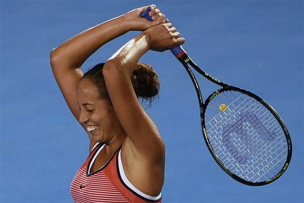 Madison Keys celebrates her second round win over