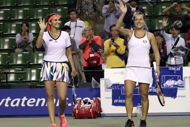 Sania Mirza and Barbora Strycova wave to the crowd after their second round victory.
